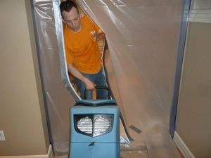 Technician Setting Up A Vapor Barrier In A Commercial Property